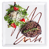 Grilled beef. Garnished salad with parmesan cheese Stock Image