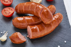 Grilled beef Italian Sausages in Black Stone Plate Royalty Free Stock Image