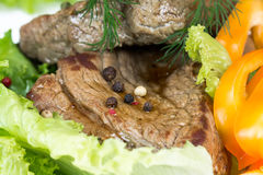 Grilled beef on lettuce leaves Royalty Free Stock Photos