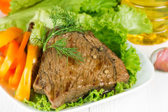 Grilled beef on lettuce leaves Stock Images