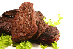 Grilled beef meat and green salad over white Stock Photo