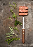 Grilled beef meat herbs spices on kitchen desk. Food background Royalty Free Stock Images