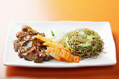 Grilled beef with noodles Royalty Free Stock Photo