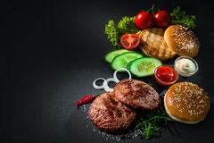 Grilled beef patties with other ingredients for hamburgers Royalty Free Stock Images