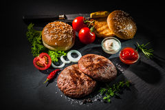 Grilled beef patties with other ingredients for hamburgers Stock Photography