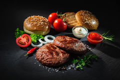Grilled beef patties with other ingredients for hamburgers Stock Image