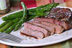 Grilled Beef Ribeye with Asparagus Stock Photo