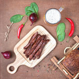Grilled beef sausages with beer. Stock Photo