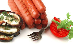 Grilled beef sausages on white Royalty Free Stock Image