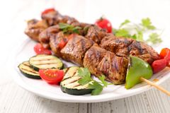 Grilled beef skewer. And zucchini royalty free stock images