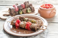 Grilled beef skewers with pepper and brussels Royalty Free Stock Photos