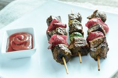 Grilled beef skewers with pepper and brussels Royalty Free Stock Photo