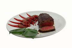 Grilled beef steak. On a white dish stock photos