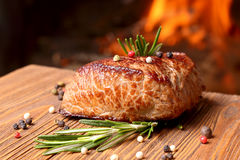 Grilled beef steak on a background of fire Stock Photography