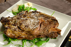 Grilled beef steak with bone Royalty Free Stock Image