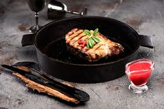 Beef steak in a cast-iron frying pan Stock Photography