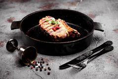Grilled beef steak in a cast-iron frying pan Royalty Free Stock Photography
