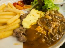Grilled beef steak with cheese Royalty Free Stock Image