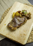Grilled Beef Steak. On the chopping board Stock Photo