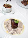 Grilled beef steak with cream mushroom sauce Stock Image