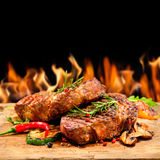 Grilled beef steak with flames Stock Images