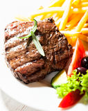 Grilled beef steak with french fries Stock Photos