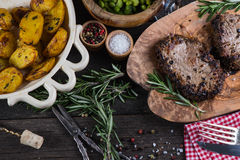 Grilled beef steak with fresh herbs and roasted potatoes Royalty Free Stock Photo