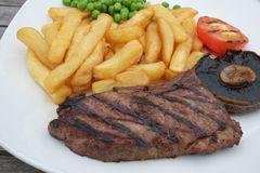 Grilled beef steak and fries Royalty Free Stock Photography
