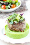Grilled beef steak, green mashed potatoes with peas, herbs, tast Stock Image
