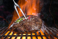 Grilled beef steak on the grill. Stock Images