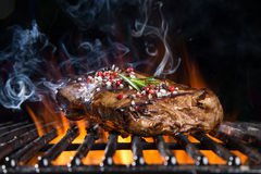 Grilled beef steak on the grill. Stock Photos