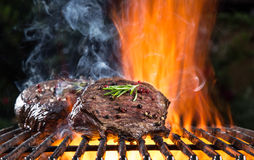 Grilled beef steak on the grill. Royalty Free Stock Image