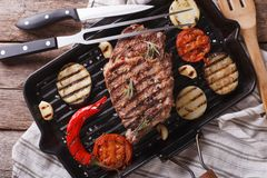 Grilled beef steak on the grill pan closeup, horizontal top view Stock Image