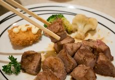 Grilled beef steak. Beef steak japanese style food on white plate Stock Photos