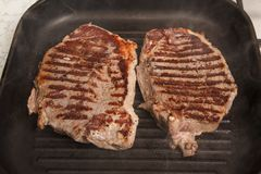 Grilled beef steak. In  the pan Stock Photos