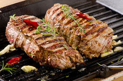 Grilled Beef steak with  herbs Royalty Free Stock Photos