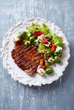 Grilled beef steak with mediterranean-style salad stock photo