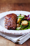 Grilled Beef Steak with Pan-Cooked Vegetables Stock Photos