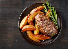 Grilled beef steak and potatoes Stock Image