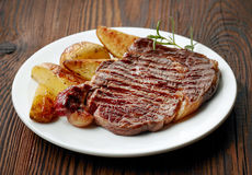 Grilled beef steak and potatoes Stock Photo