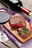 Grilled beef steak and red wine Royalty Free Stock Image