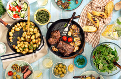 Grilled Beef Steak, Roast New Potatoes And Different Food Stock Image