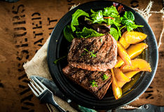 Grilled beef steak with roasted pumpkin Stock Image