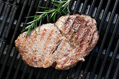 Grilled beef steak with rosemary Royalty Free Stock Photo