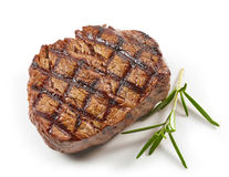 Grilled beef steak. And rosemary isolated on white background, top view Royalty Free Stock Image