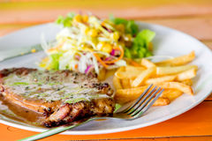 Grilled beef steak. With salad Royalty Free Stock Image