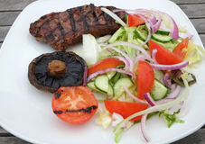 Grilled beef steak and salad Stock Image