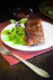 Grilled beef steak with salad and sauce on wooden table Stock Image