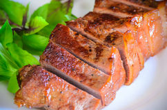Grilled beef steak with salad and sauce on wooden table Stock Photography
