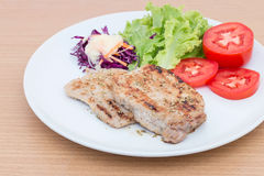 Grilled beef steak with salad. On wooden board Royalty Free Stock Image